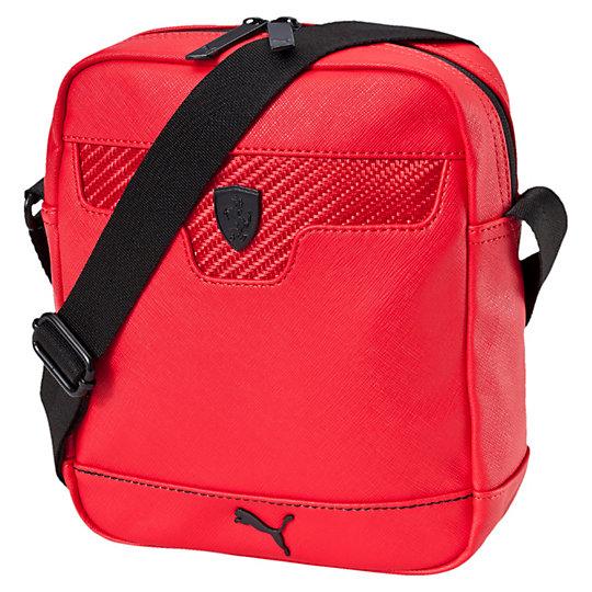 Сумка Ferrari LS PortableСумки<br>Наплечная сумка Ferrari Shoulder Bag<br>Небольшая наплечная сумка из коллекции Ferrari Lifestyle сохранит самые важные вещи, пока вы гуляете по городу. Дополните ею любой повседневный костюм и приобретите стильный вид раньше, чем успеете сказать «Скудерия Феррари». Классический силуэт и достаточный объем для переноски нужных вещей. Это сумка для настоящих любителей автоспорта.<br><br>Коллекция: Осень-зима 2016<br>Материал: 93% полиуретан, 7% полиэстер с полиуретановой подкладкой<br>Размеры: Длина 20 см, ширина 7 см, высота 24 см (3,5 л) Цвета: черный, красный<br>Внутренний карман на молнии и накладной карман<br>Регулируемая плечевая лямка из тесьмы<br>Металлический логотип Ferrari в виде щита, фурнитура матового черного цвета<br>Страна-производитель: Гонконг<br><br><br>size RU: OSFA<br>gender: Unisex