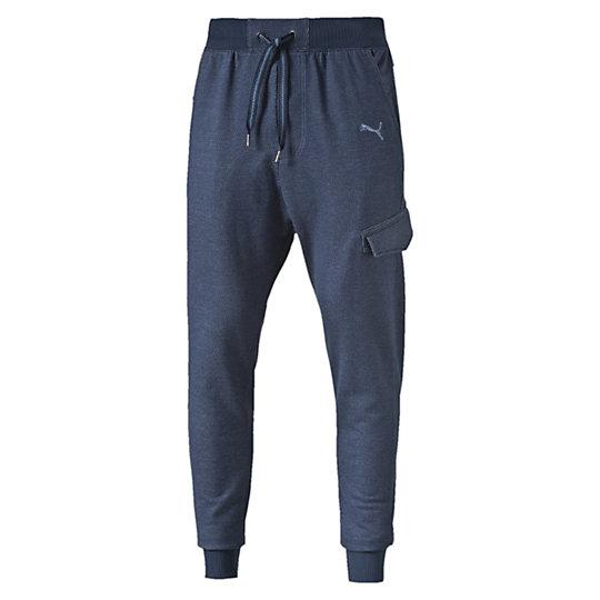 Брюки STYLE Sweat Pants TR, cl.Брюки<br>Брюки STYLE Sweat Pants, TR, cl.<br><br>Брюки STYLE Sweat Pants, TR, cl. от Puma - это комфорт и стиль в одном. Мужские брюки, созданные из хлопка станут удобной одеждой на каждый день, отлично регулируют температуру тела. Мягкий натуральный материал, боковые карманы, пояс на регулируемой тесьме и манжеты на штанинах создают максимальный комфорт для ношения в любой ситуации. Брюки украшены вышитым логотипом Puma.<br><br><br>        Коллекция: Весна-лето 2016 года<br>        Графический принт с логотипом Puma<br>        Боковые карманы<br>        Материал: 100% хлопок<br><br><br>color: синий<br>size RU: 48-50<br>gender: Male