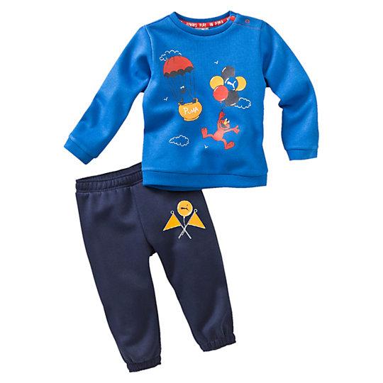 Костюм Sesame Street JoggerОдежда<br>Спортивный костюм Sesame JoggerИграть станет еще интереснее в костюме для бега из двух вещей от PUMA и «Улицы Сезам».Коллекция: Осень-зима 2016Состав: 66% хлопок, 34% полиэстерЦвет: синийПуговицы по левой стороне воротникаЭластичная рельефная отделка для лучшей посадки по фигуреСтрана-производитель: Бангладеш<br><br>size RU: 74<br>gender: Unisex